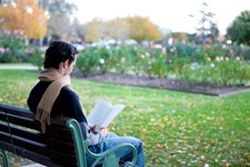 Person reading on a bench in the Benalla Botanical Gardens